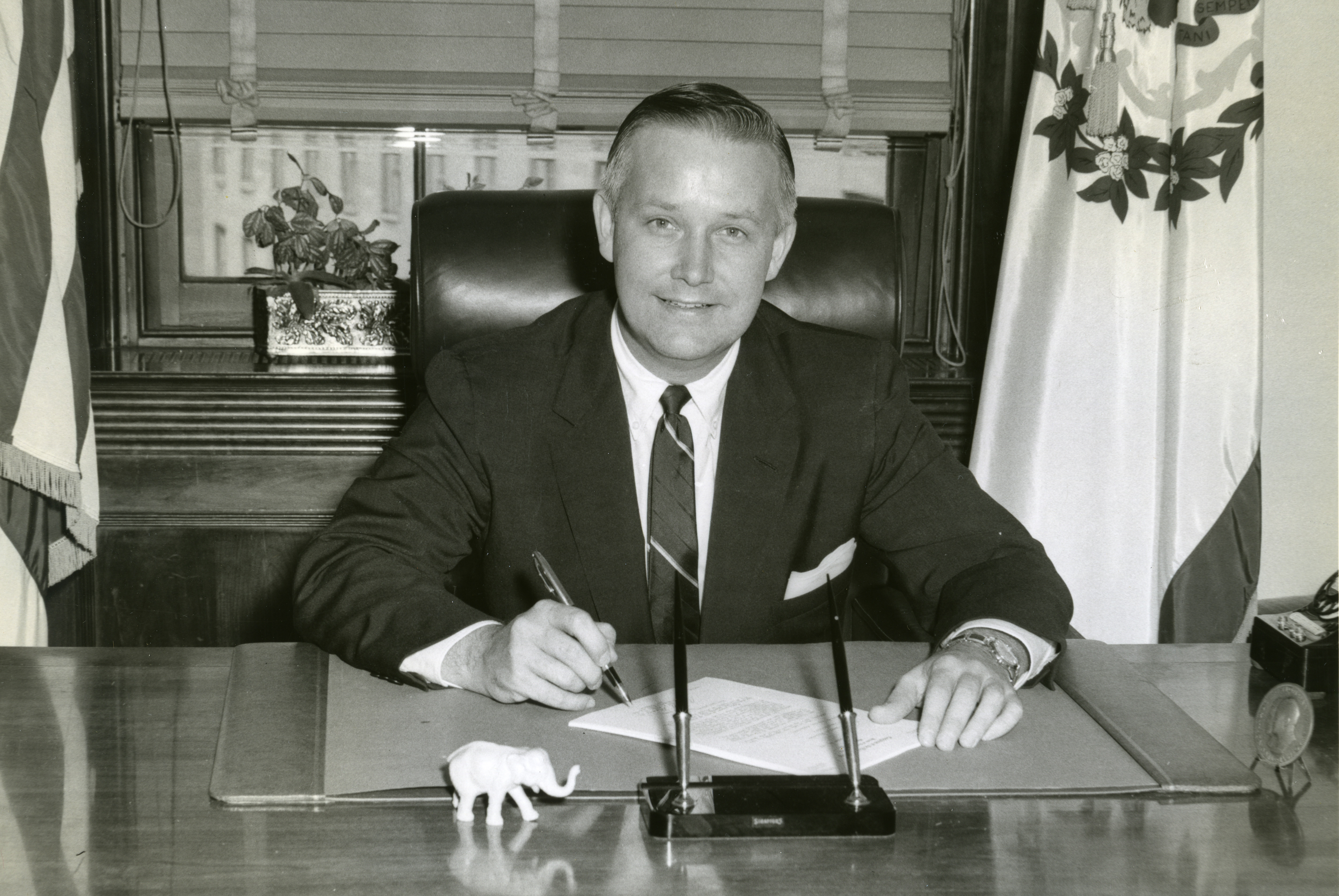 Representative Arch Moore poses at his desk in his Washington, D.C., office.