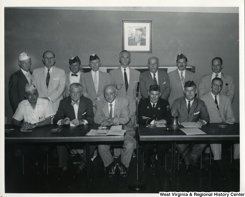A group of unidentified veterans at the Veterans Service Office in Weirton, W.Va. and Congressman Arch Moore, Jr. Moore is seated in the front row, second from the right.