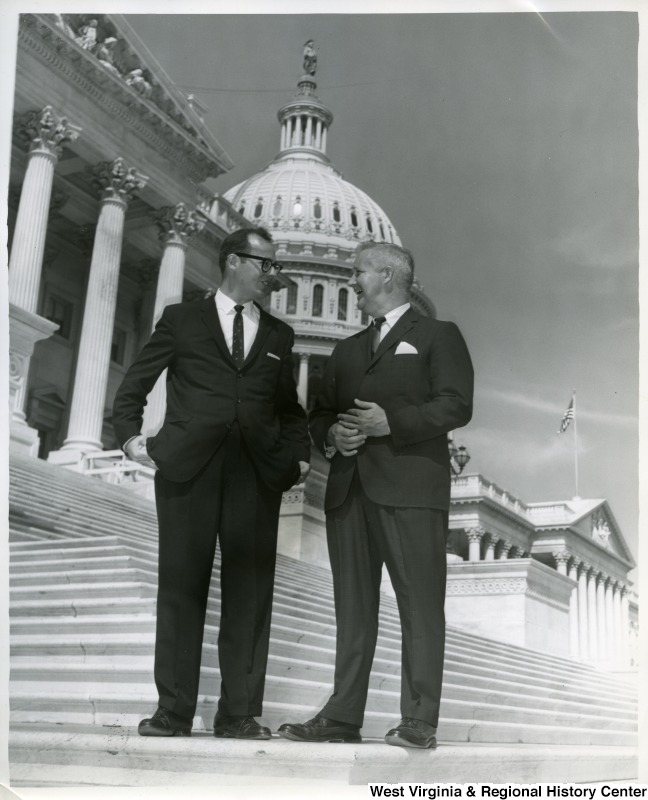 Congressman Arch Moore, Jr. with an unidentified man on the steps of the Capitol Building.
