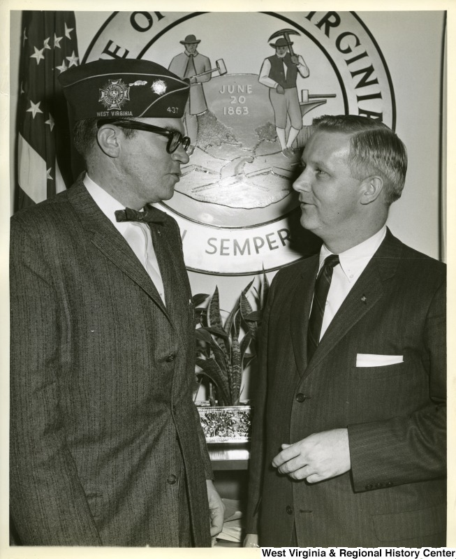 Congressman Arch Moore Jr. talking to an unidentified member of the Veterans of Foreign Wars of the US.