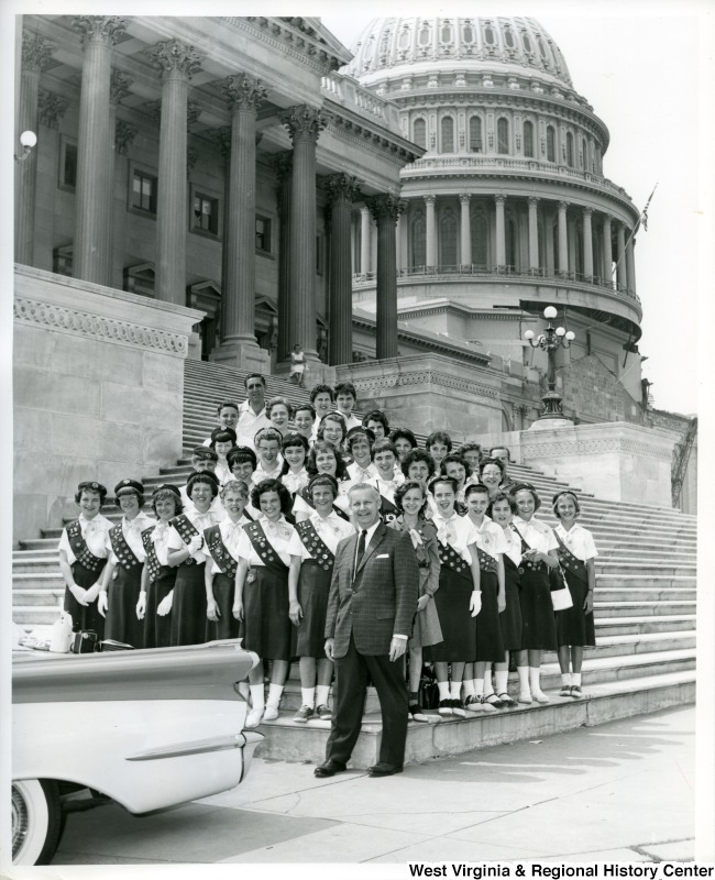 Congressman Arch Moore, Jr (front, center) standing on the steps of the Capitol with 32 Girl Scouts, comprised of Wheeling Troops 3 and 12 and their leader, Mrs. C. W. Prettyman.