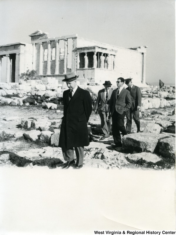 Congressman Arch A. Moore, Jr. walking away from the Erechtheion. Three other unidentified people are following behind him.