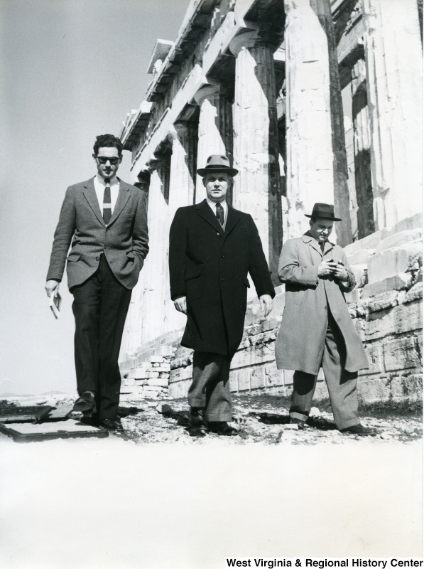 Congressman Arch A. Moore, Jr. (center) walking beside the Parthenon with two unidentified men.