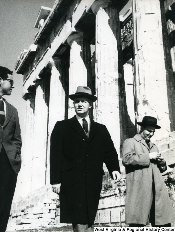 Congressman Arch A. Moore, Jr. with two unidentified men walking outside the Parthenon.