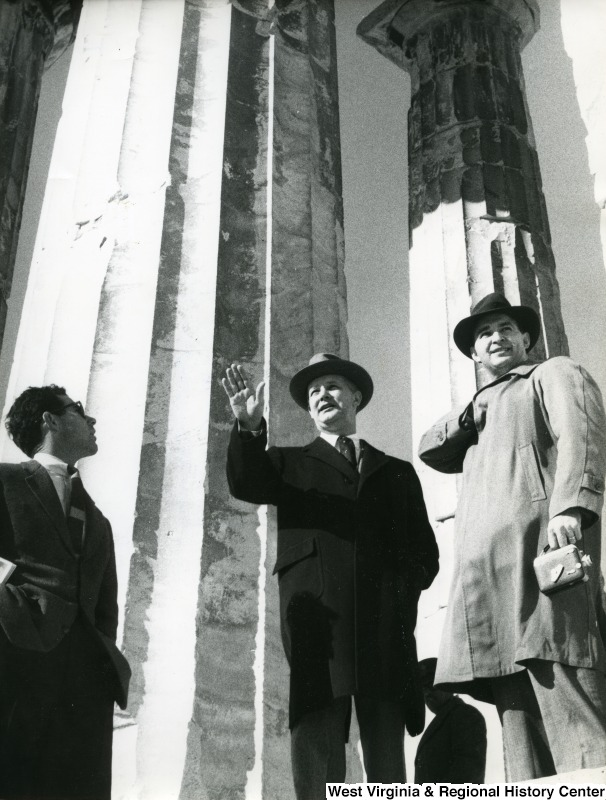 Congressman Arch A. Moore, Jr. talking with two unidentified men. They are standing in the Parthenon.