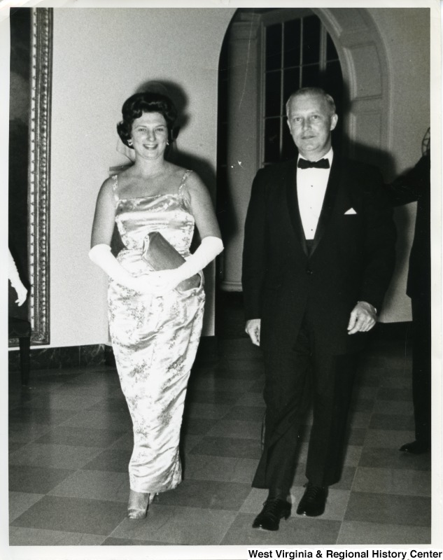 Congressman Arch A. Moore, Jr. with his wife Shelley Moore. Moore is wearing a tux and Shelley is in an elegant dress with elbow length gloves.