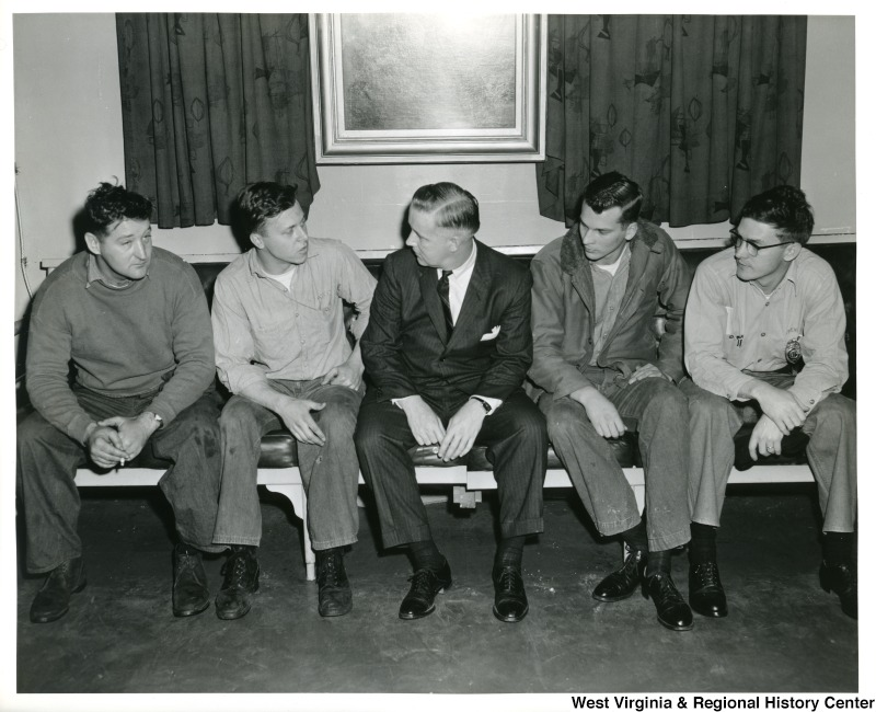 Congressman Arch A. Moore, Jr. (center) talking to four crew members of the U.S.S. Franklin D. Roosevelt.