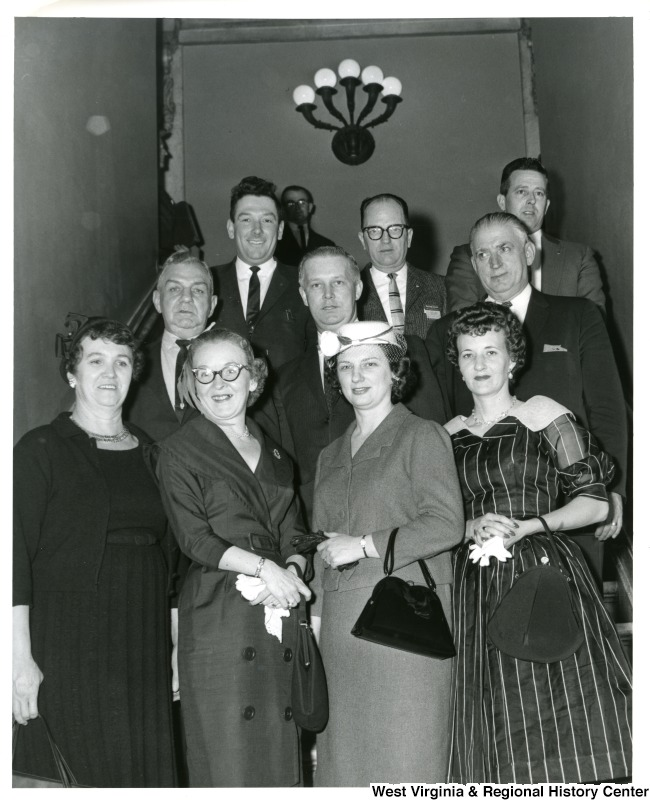 Congressman Arch A. Moore, Jr. with his wife, Shelley Moore (front, second from right) and someone identified only as Ringler. The remaining individuals in the photograph are unidentified.