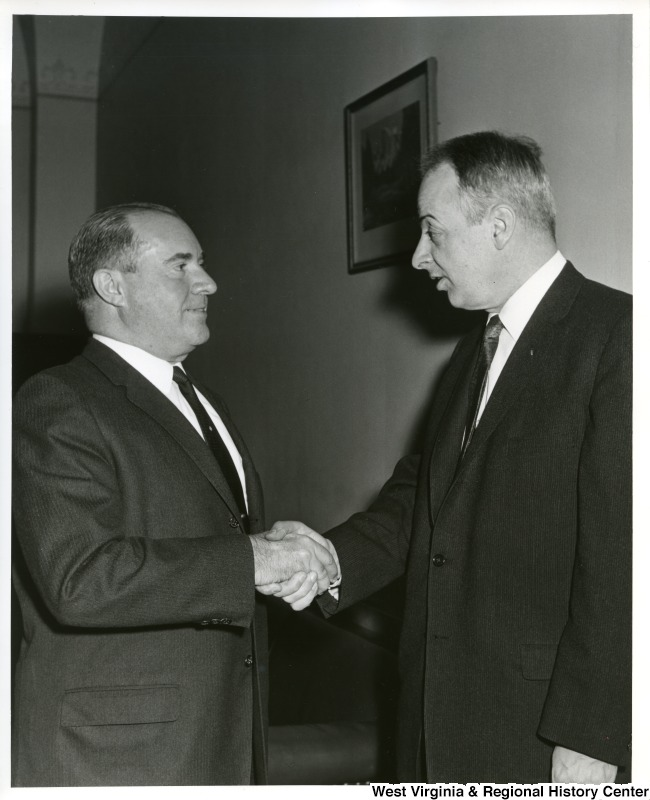 Two unidentified men are shaking hands.