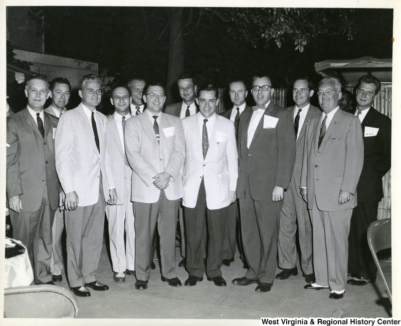 A large group of Republican representativesFront left to right: Congressman Arch A. Moore, Jr. (R - WV) , unknown, Congressman Robert Griffin (R - MI) , Congressman William Broomfield (R - MI), Congressman Donald Tewes (R - WI) , unknown, and Harold R. Collier (R - IL). The other congressmen are unidentified.