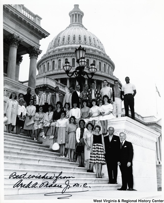 "Congressman Arch A. Moore, Jr. with an unidentified group of men and women on the steps of the Capitol. The photograph is signed ""Best wishes from Arch A. Moore, Jr. """