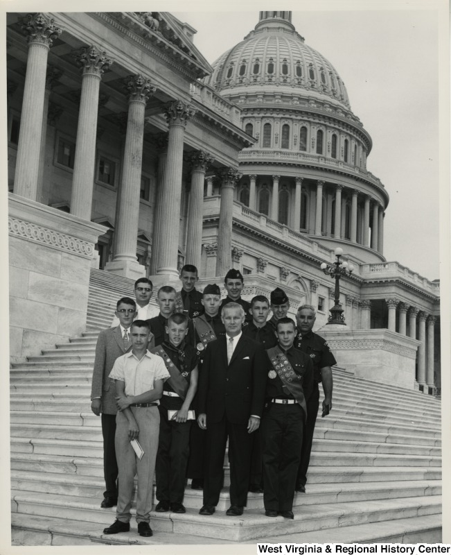 Congressman Arch A. Moore, Jr. (front, center) with a small group of Boy Scouts on the steps of the Capitol.