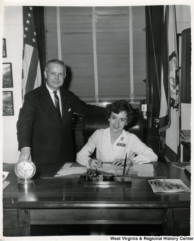 Congressman Arch A. Moore, Jr. standing beside Miss Norma Lee Kerns of Moundsville, W.Va. Kerns was in Washington as West Virginia's representative to the Veterans of Foreign Wars (VFW) Voice of Democracy Contest.