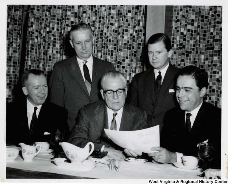 Congressman Arch A. Moore, Jr. with four unidentified men at the West Virigina RSVP dinner.