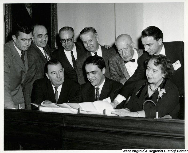 The West Virginia delegation. Seated right to left: Maude Elizabeth Kee, Governor Cecil H. Underwood and Jennings Randolph. Standing right to left: Robert C. Byrd, Cleveland Bailey, Arch A. Moore, Jr., Ken Hechler, unknown, and John M. Slack, Jr.