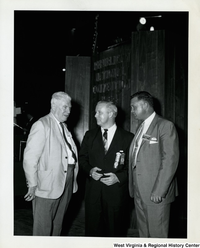 Congressman Arch A. Moore, Jr. at the Republican National Convention in California. On the right side of Moore is Wayne Bromley, a member of the press, and an unidentified man is on the other side.
