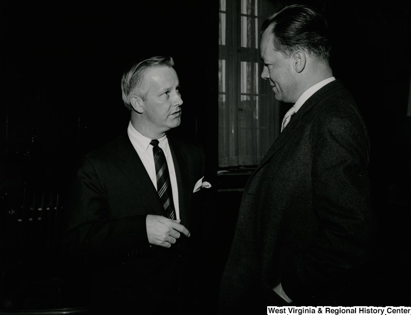 Congressman Arch A. Moore, Jr.  talking to an unidentified man.