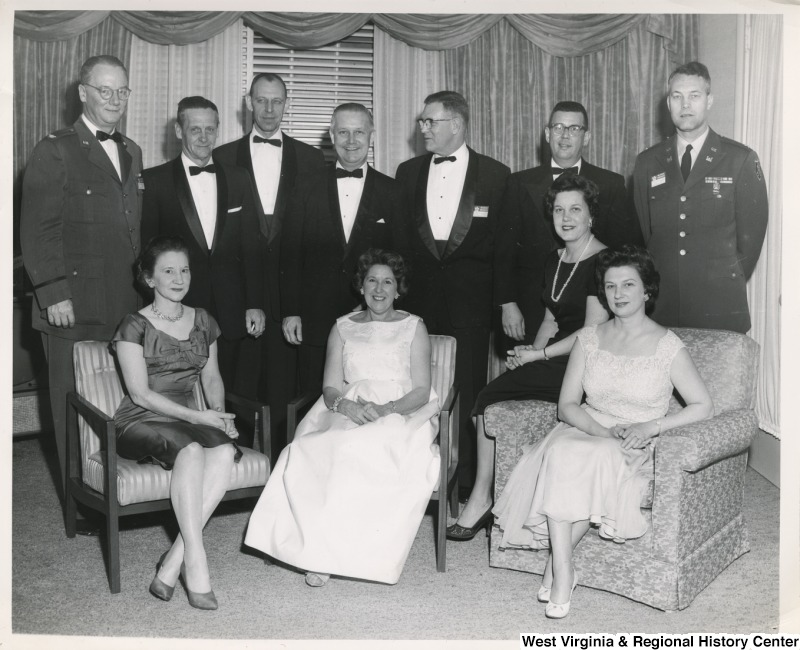 Congressman Arch A. Moore, Jr. and Mrs. Shelly Moore with an unidentified group of men and women.