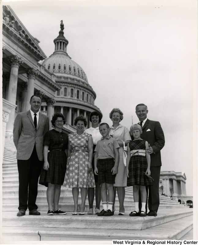 Congressman Arch A. Moore, Jr. standing on the steps of the Capitol with an unidentified group of adults and children.