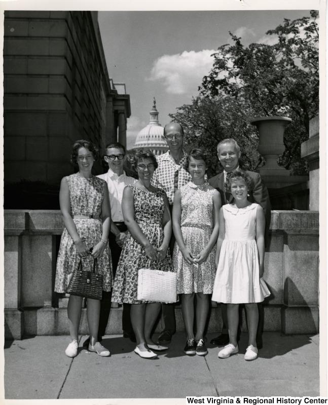 Congressman Arch A. Moore, Jr. standing with an unidentified family of six.