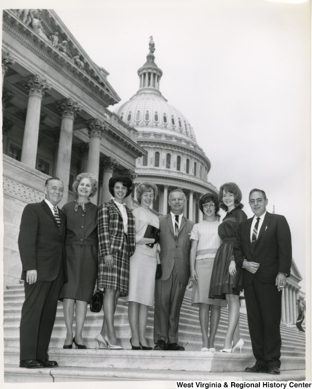 Congressman Arch A. Moore, Jr. on the steps of the Capitol with seven unidentified people (five women and two men).