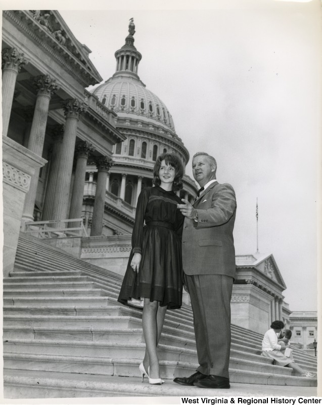 Congressman Arch A. Moore, Jr. standing with an unidentified woman on the steps of the Capitol.