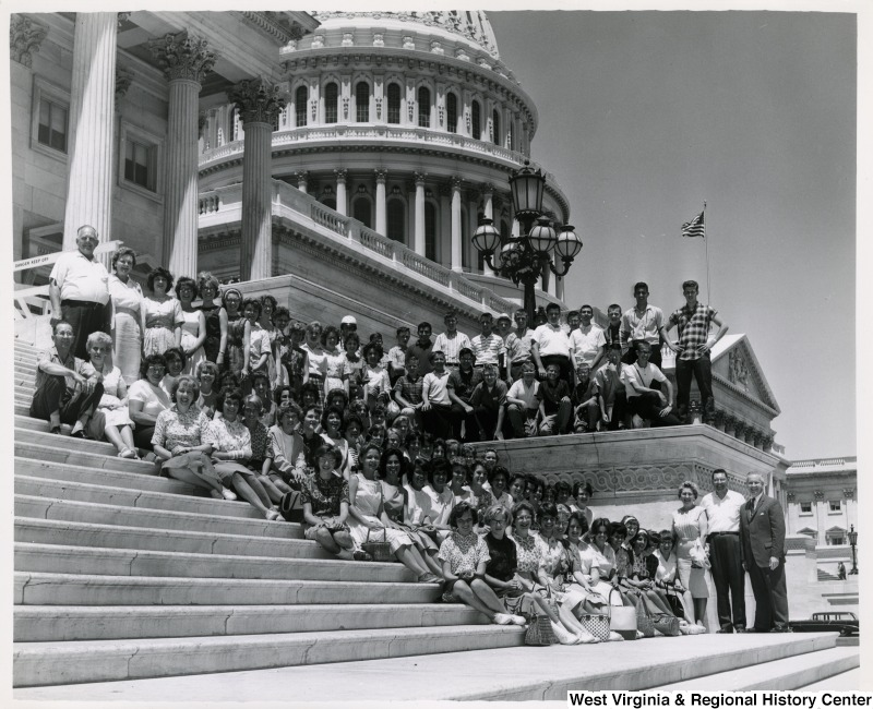 Congressman Arch A. Moore, Jr. standing on the steps of the Capitol with a large unidentified group of people.