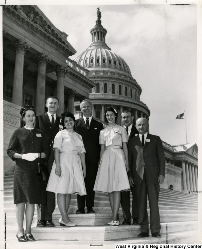 Congressman Arch A. Moore, Jr. on the steps of the Capitol with Miss Rose Lee Matthews, Miss Jorene Butcher, Mr. Richard Steven Hannah, Mr. Edwin Hill Chesapeake, Miss Mildred Fizer, and Mr. C. P. Dorsey.  The group attended the annual National 4-H Conference which was held at the National 4-H Center in Washington, the week of April 20-26. Miss Matthews, was one of the four selected to attend.