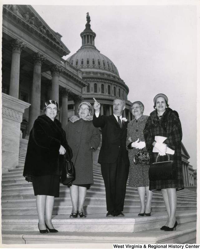 Congressman Arch A. Moore, Jr. standing on the steps of the Capitol with four unidentified women.