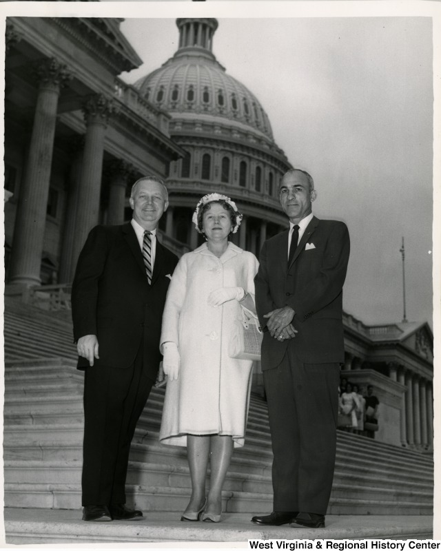 Congressman Arch A. Moore, Jr. standing on the steps of the Capitol with an unidentified man and woman.