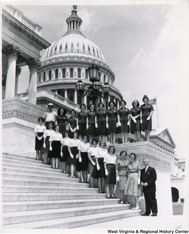Congressman Arch A. Moore, Jr. standing on the steps of the Capitol with an unidentified group of women. They are wearing uniforms.