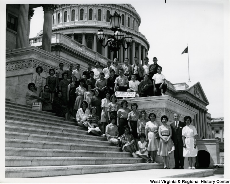 Congressman Arch A. Moore, Jr. standing on the steps of the Capitol with students from St. John's School, in Wellsburg, W.V.