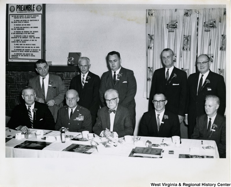 Congressman Arch A. Moore, Jr. (seated first on the left) with nine unidentified men during a Weirton Steel event.