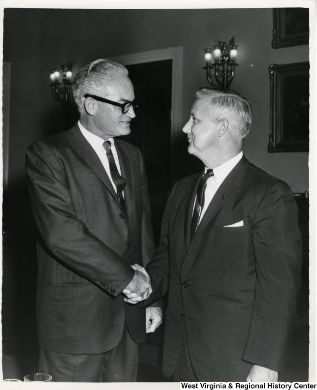 Congressman Arch A. Moore, Jr. shaking the hand of Congressman Barry Goldwater.