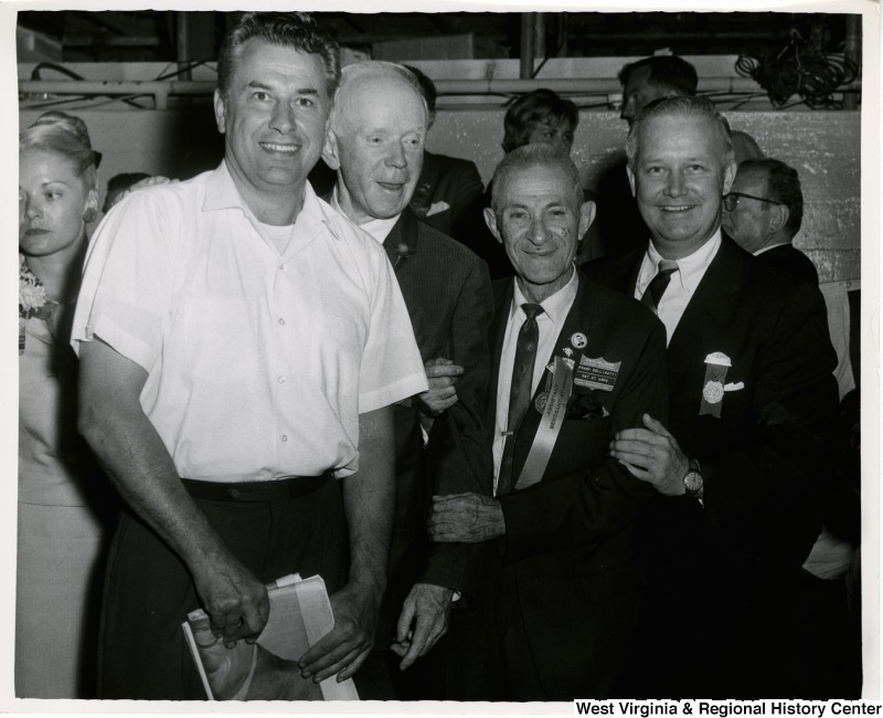 Congressman Arch A. Moore, Jr. standing with Frank Delligatti, Sergeant-at-Arms, and two other unidentified men during the Republican National Convention.