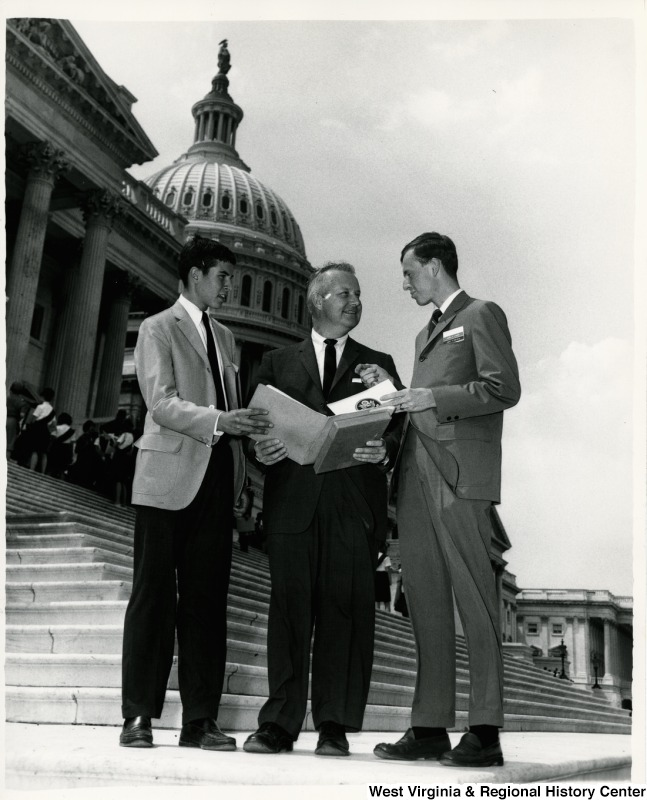 Congressman Arch A. Moore, Jr. standing between Rush Holt, Jr. (left), son of the late U.S. Senator Rush D. Hold of West Virginia, and James P. Lynch of Bridgeport, who represented W.V. at the National YMCA Youth Government Conference held in Washington. Lynch was state governor of the W.V. YMCA Youth Government Conference. Holt was on the staff of the National YMCA Youth Government Program.