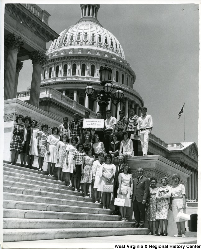 Congressman Arch A. Moore, Jr. standing on the Capitol steps with the 1965 graduating class of Barrackville High School.