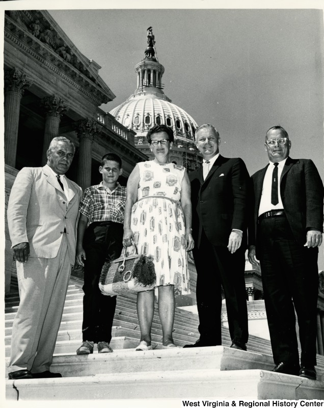 Congressman Arch A. Moore, Jr. on the steps of the Capitol with Mr. John Byard and family.