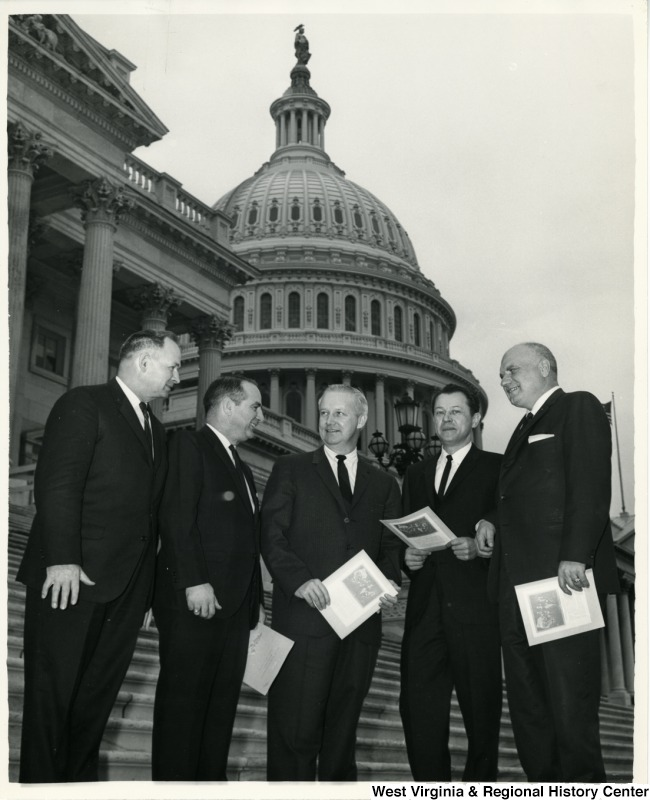 Outlook for legislation that will affect the coal industry is being discussed by Congressman Arch A. Moore, Jr. (center) with Robert E. Lee Hall, vice president of the National Coal Association (right) and G. Don Sullivan associate director of Government Relations. They agreed that residual oil imports and subsidized atomic electric power are the major threats to continued increase in coal output, which that year will exceed 500 million tons. West Virginia's production, which accounts for almost one-third of the nation's total, is running at more than 7 percent above the 1964 output.