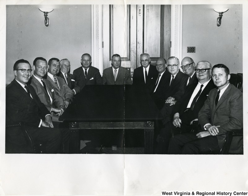 Congressman Arch A. Moore, Jr. (fifth from the left) with the Small Business Committee. From left to right: Robert P. Griffin, unknown, unknown, James J. Delaney,  Arch A. Moore, Jr.; Joe L. Evins, unknown, Abraham J. Multer, Tom Steed, unknown, unknown, and unknown.