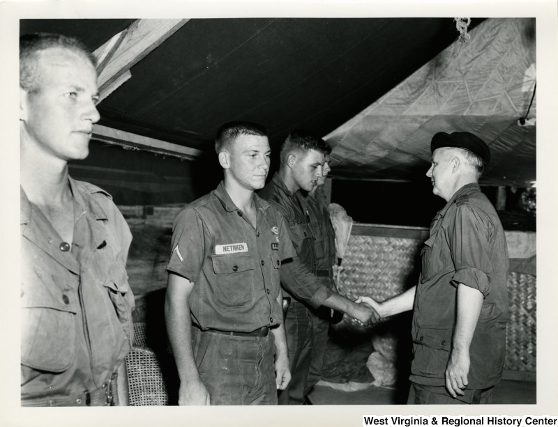 Congressman Arch A. Moore, Jr. shaking the hand of an U.S. Army officer.