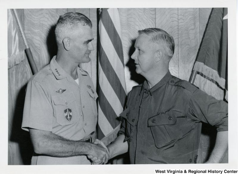 Congressman Arch A. Moore, Jr. shaking the hand of General William C. Westmoreland, commander of the U.S. Troops in Vietnam.