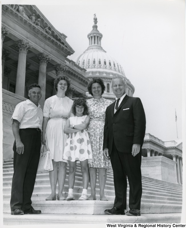 Congressman Arch A. Moore, Jr. standing on the steps of the Capitol with an unidentified West Virginia family of four.