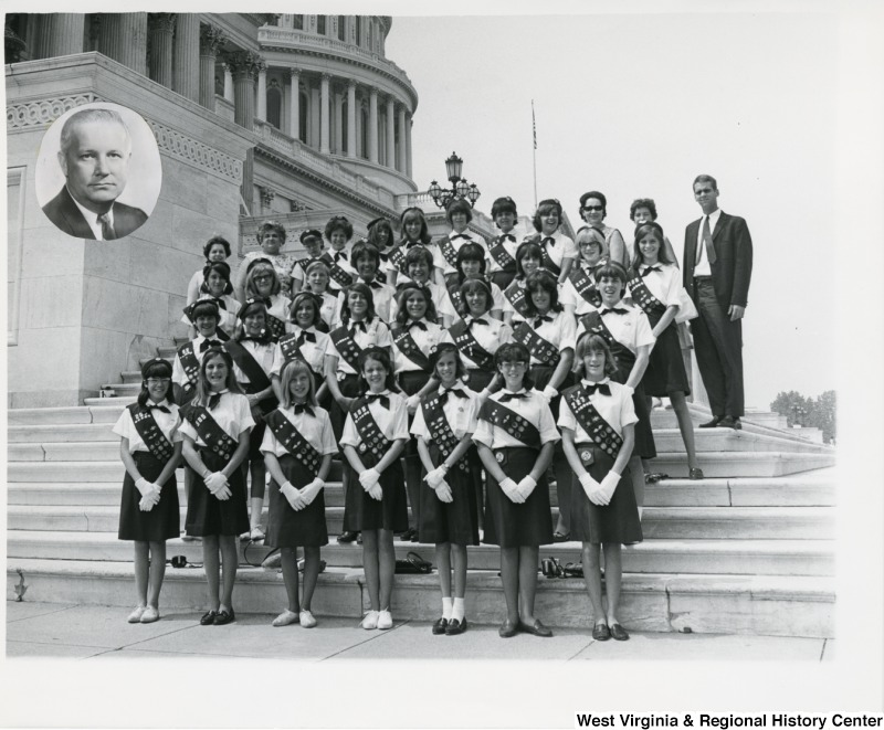 The Wheeling Girl Scouts standing on the steps of the Capitol. A portrait of Congressman Arch A. Moore, Jr. has been added at to the top left corner of the photograph.