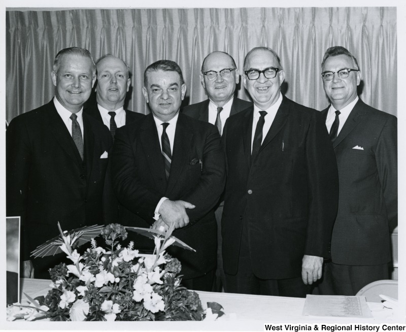 Congressman Arch A. Moore, Jr. (left) with five unidentified men at the Paul Glover Party hosted by John Jones.