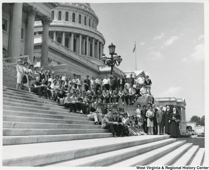 Congressman Arch A. Moore, Jr. standing on the steps of the Capitol with the Ohio County School Boy Patrol. Moore is standing beside Sisters Mary Merica and Mary Antonia of St. Ladislaus School. On the other side of Moore is Thomas Timbrook of the Wheeling Automobile Club, which sponsored the annual School Boy Patrol pilgrimage to Washington.