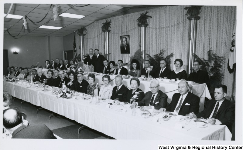 Congressman Arch A. Moore, Jr. standing at a podium during the Italian Sons and Daughters banquet in Weirton, W. Va.