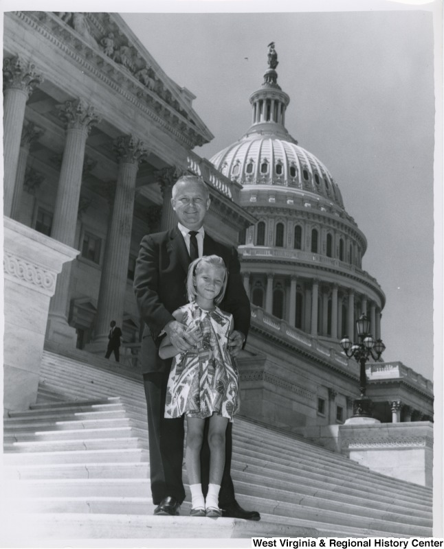 Congressman Arch A. Moore, Jr. on the steps of the Capitol with an unidentified girl.