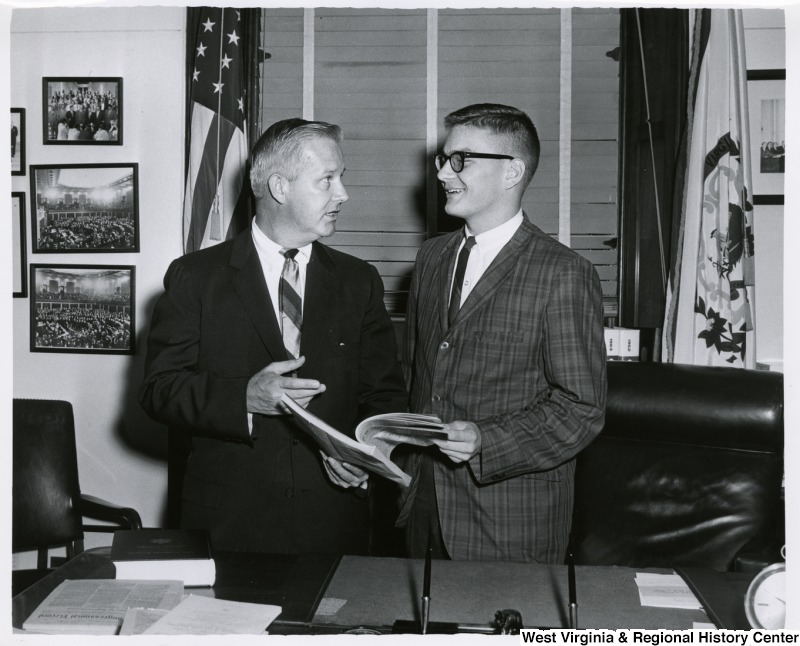 Congressman Arch A. Moore, Jr. talking to an unidentified man in his office.