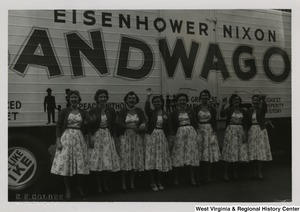 A photograph of eight women posing in front of an Eisenhower/Nixon Bandwagon bus in Wheeling, West Virginia.